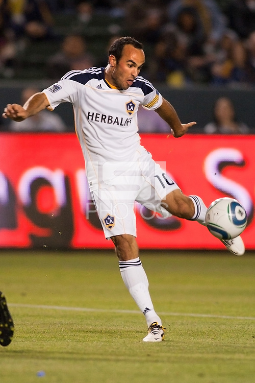 Landon Donovan (10) of the Galaxy sends a ball to the goal. The LA Galaxy defeated the Portland Timbers 3-0 at Home Depot Center stadium in Carson, California on  April  23, 2011....