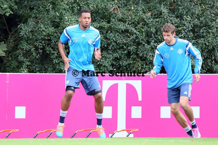 Jerome Boateng und Thomas Mueller - Training der Deutschen Nationalmannschaft in Frankfurt