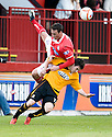 Brechin's Johnny Brown goes over the top of Alloa's Kevin Cawley ...