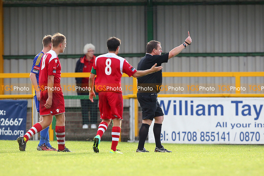 George Cocklin of Romford (out of picture) is shown a red card - Romford vs Needham Market - Ryman League Division One North Football at Ship Lane, Thurrock FC - 04/10/14 - MANDATORY CREDIT: Gavin Ellis/TGSPHOTO - Self billing applies where appropriate - contact@tgsphoto.co.uk - NO UNPAID USE