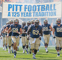 The Pitt football team takes the field against Iowa. Seen are Quintin Wirginis (58), Alex Oficer (63), Adam Bisnowaty (69) and John Guy (62). Iowa Hawkeyes defeated the Pitt Panthers 24-20 at Heinz Field, Pittsburgh Pennsylvania on September 20, 2014.