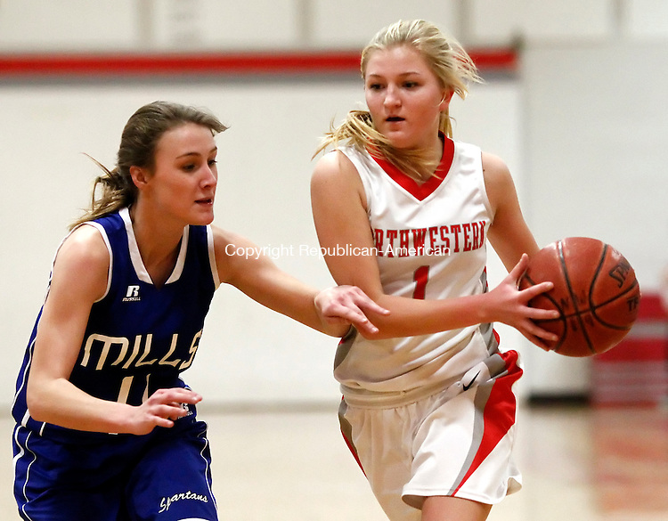 Winsted, CT- 05 January 2015-010515CM06 Northwestern's Kelsi Hodgkin looks to pass around Lewis Mills' Ruta Martisauskaite during their Berkshire League matchup in Winsted on Monday.   Christopher Massa Republican-American