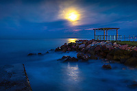 Fine Art Landscape Photograph of moonlight on the Pacfic ocean. <br /> This photograph is one of those rare moments when the night light from the full moon is the only light that is lighting the ocean and shoreline.