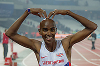 A happy Mo Farah of GBR (Men's 3000m) after his victory does his trademark M during the Sainsburys Anniversary Games Athletics Event at the Olympic Park, London, England on 24 July 2015. Photo by Andy Rowland.