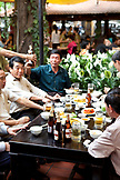 VIETNAM, Hanoi, men drink and eat lunch at a traditional street food restaurant called Quan An Ngon