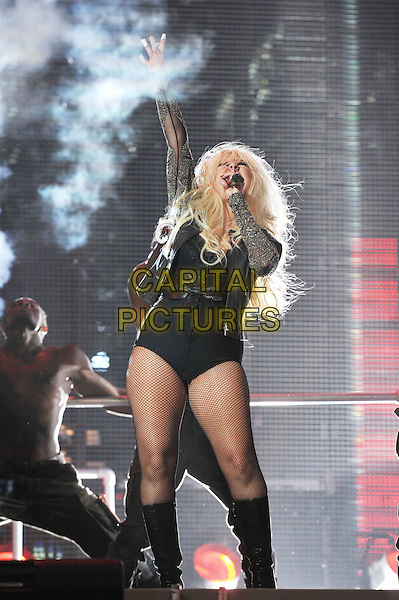 Christina Aguilera.Michael Forever Tribute Concert at The Millenium Stadium, Cardiff, Wales, UK 8th October 2011.performing live in on stage music gig full length black leotard grey gray jacket singing fishnet stockings boots arm in air .CAP/MAR.© Martin Harris/Capital Pictures.