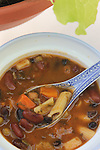 Home made, tomato Minestrone soup with black beans,  dark red kidney beans  light kidney beans, celery, tomatoes, onions, carrots. ©2016. Jim Bryant. All Rights Reserved.
