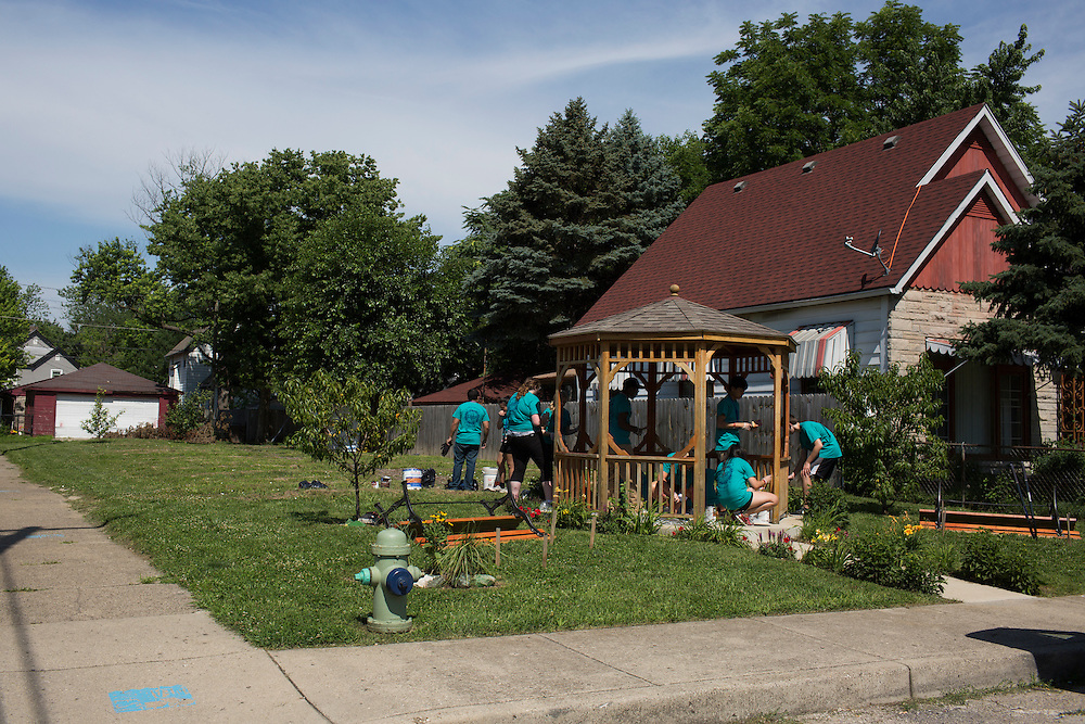 """Members work on a garden during """"Circle the City with Service,"""" the Kiwanis Circle K International's 2015 Large Scale Service Project, on Wednesday, June 24, 2015, in Indianapolis. (Photo by James Brosher)"""