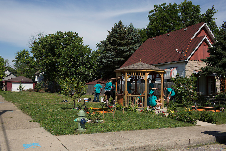"Members work on a garden during ""Circle the City with Service,"" the Kiwanis Circle K International's 2015 Large Scale Service Project, on Wednesday, June 24, 2015, in Indianapolis. (Photo by James Brosher)"