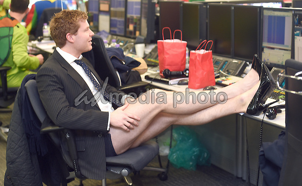 09 December 2015 - London, England - ICAP Brokers in Heels at ICAP's 23rd annual Charity Day. They join ICAP's brokers in its London office to speak to customers to close deals and help boost trading volumes during the day. Photo Credit: Alpha Press/AdMedia
