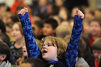 NWA Media/ J.T. Wampler - THannah Akehurst throws her hands in the air while singing holiday songs Thursday Dec. 18, 2014 during the Rogers Northside Elementary School holiday sing-a-long. The annual holiday event also featured Academy Sports + Outdoors donating bikes and helmets to 30 deserving students (15 girls and 15 boys) as part of Academy's annual bike donation program.