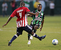 Chivas USA defender Shavar Thomas (4) battles Santos forward Christian Benitez (11) for a ball. Chivas USA defeated the Santos of Laguna 1-0 during the 1st round of the 2008 SuperLiga at Home Depot Center stadium, in Carson, California on Wednesday, July 16, 2008.