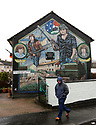 A man walks past an Irish Republican mural in, west Belfast, Tuesday, April 10th, 2018. Tuesday marks 20 years since politicians from Northern Ireland and the British and Irish governments agreed what became known as the Good Friday Agreement. It was the culmination of a peace process which sought to end 30 years of the Troubles. Two decades on, the Northern Ireland Assembly is suspended in a bitter atmosphere between the two main parties. Photo/Paul McErlane