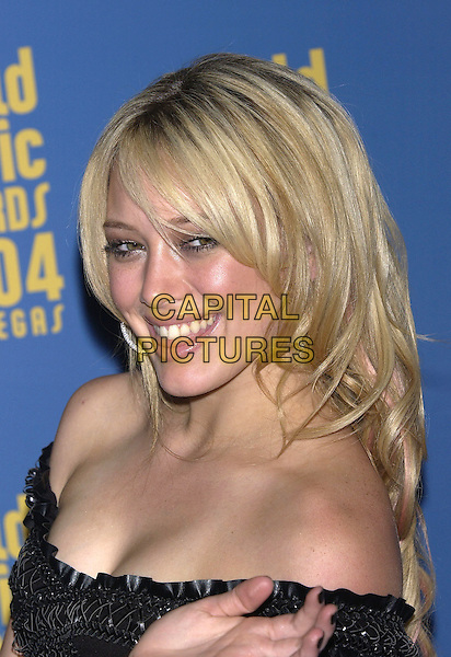 HILLARY DUFF.The World Music Awards (WMA's), Las Vegas, Nevada, USA, September 15th 2004..portrait headshot.Ref: PL.www.capitalpictures.com.sales@capitalpictures.com.©Capital Pictures.