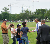 United States President Barack Obama (right) greets tourists  as he walks from the United States Department of the Interior to the White House after signing an Executive Order, Wednesday, May 21, 2014 on the Ellipse in Washington, DC.<br /> Credit: John Harrington / Pool via CNP