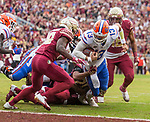 Florida quarterback Feleipe Franks (13) is brought down just short of the end zone in the 1st half of an NCAA college football game against Florida State in Tallahassee, Fla., Saturday, Nov. 24, 2018. (AP Photo/Mark Wallheiser)