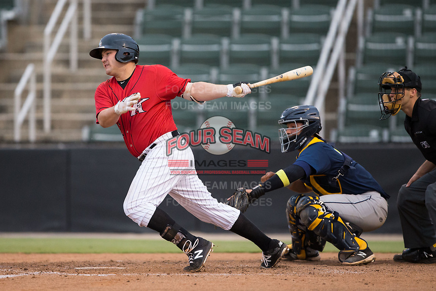 Jake Burger (31) of the Kannapolis Intimidators follows through on his swing against the Columbia Fireflies at Kannapolis Intimidators Stadium on July 23, 2017 in Kannapolis, North Carolina.  The Fireflies defeated the Intimidators 3-1.  (Brian Westerholt/Four Seam Images)