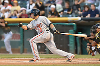 Juan Perez (18) of the Fresno Grizzlies at bat against the Salt Lake Bees at Smith's Ballpark on May 25, 2014 in Salt Lake City, Utah.  (Stephen Smith/Four Seam Images)