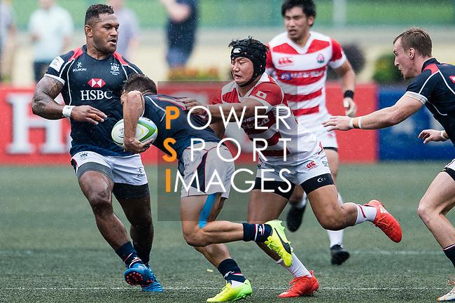Kanta Shikao of Japan (R) puts a tackle on Tyler Spitz of Hong Kong (L) during the Asia Rugby Championship 2017 match between Hong Kong and Japan on May 13, 2017 in Hong Kong, China. Photo by Marcio Rodrigo Machado / Power Sport Images