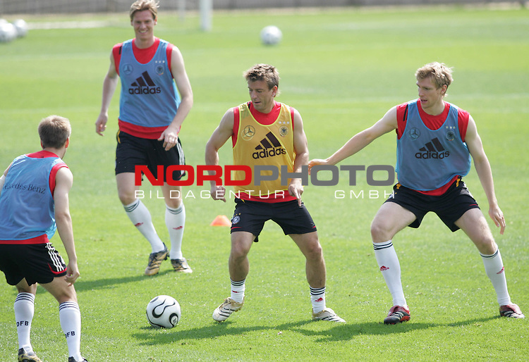 FIFA WM 2006 - Training - Germany<br /> Philipp Lahm, Tim Borowski, Bernd Schneider and Per Mertesacker (l-r) with ball during a training session at the World Cup in Berlin (Stadion Wurfplatz). <br /> Foto &copy; nordphoto