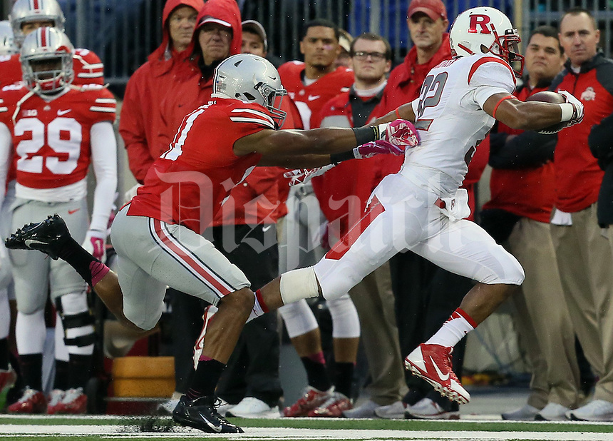 Ohio State Buckeyes defensive back Vonn Bell (11) forces Rutgers Scarlet Knights running back Justin Goodwin (32) out of bounds in the third quarter of their game at Ohio Stadium in Columbus, Ohio on October 18, 2014. (Columbus Dispatch photo by Brooke LaValley)