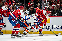 WASHINGTON, DC - JANUARY 31: Jakub Vrana #13 of the Washington Capitals  breaks away from the Islanders defenders during a game between New York Islanders and Washington Capitals at Capital One Arena on January 31, 2020 in Washington, DC.