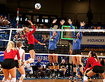 BROOKINGS, SD - SEPTEMBER 25:  Audrey Reeg #4 from the University of South Dakota tries to tip the ball past Mikala Hora #14 and Ashley Beaner #11 from South Dakota State University during their match Sunday afternoon at Frost Arena. (Photo by Dave Eggen/Inertia)