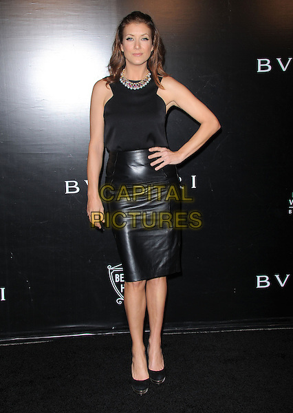 Kate Walsh.Rodeo Drive Walk of Style 2012 held on Rodeo Dr., Beverly Hills, California, USA..December 5th, 2012 .full length hand on hip black sleeveless top skirt leather .CAP/DVS.©DVS/Capital Pictures.