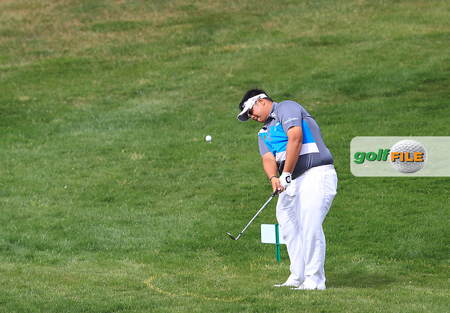 Kiradech Aphibarnrat (THA) chips his drop shot into the 12th green during Saturday's Round 3 of the 2013 Omega European Masters held at Crans Montana Golf Club, Crans-Sur-Sierre Switzerland. 7th September 2013.<br /> Picture: Eoin Clarke www.golffile.ie