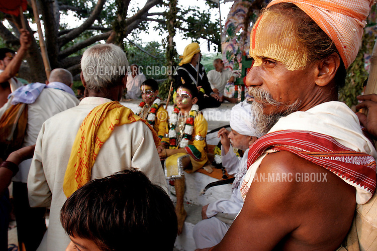 .RAMNAGAR, UTTAR PRADESH, INDIA - OCTOBER 10, 2005 : A sadhu, Hindu Holy man, never leave the side of the boys representing the gods Ram and Lakshman on day 24 of the Ramlila, October 10, 2005. The Ramlila is the play of the Hindu scripture 'the Ramayana', translated by poet Tulsidas in Varanasi 500 years ago, which depict the epic adventures of the god Ram and his struggle against the Demon-King Ravana. The Ramlila of Ramnagar has been organized by the Maharaja of Benares since the early 1800s and is still its most authentic rendition, a reference to other Ramlilas. It last for 31 days and is staged over a 10 square mile area and it is still the largest theatre production in the world .(Photo by Jean-Marc Giboux)