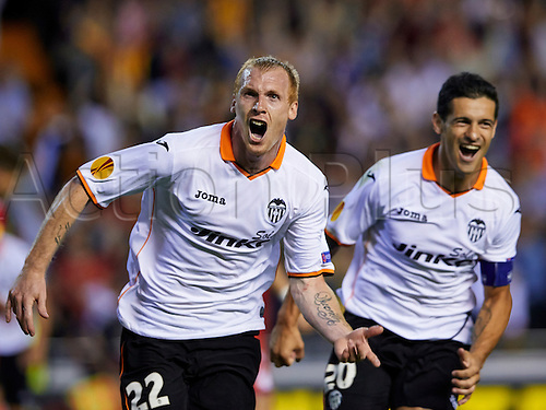 01.05.2014 Valencia, Spain. Defender Jeremy Mathieu of Valencia CF (L) celebrates after scoring the third goal for his team during the Europa Leauge Semi Finals between Valencia CF and Sevilla CF  at Mestalla stadium, Valencia