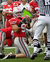 September 27, 2008: Ohio State linebacker Ross Homan (51) recovers a fumble. The Ohio State Buckeyes defeated the Minnesota Gophers 34-21 on September 27, 2008 at Ohio Stadium, Columbus, Ohio.