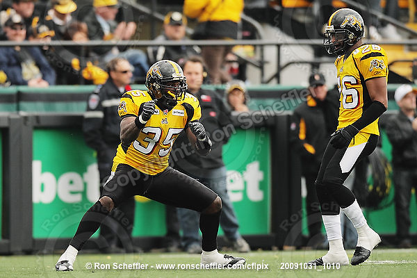 October 31, 2009; Hamilton, ON, CAN;  Hamilton Tiger-Cats linebacker Otis Floyd (35) celebrates breaking up a pass intended for Saskatchewan Roughriders running back Wes Cates. CFL football: Saskatchewan Roughriders vs. Hamilton Tiger-Cats at Ivor Wynne Stadium. The Tiger-Cats defeated the Roughriders 24-6. Mandatory Credit: Ron Scheffler. Copyright (c) 2009 Ron Scheffler.