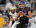 SIOUX FALLS, SD, OCTOBER 8: Quarterback Luke Papillion #15 from the University of Sioux Falls looks for a receiver against Southwest Minnesota State University in the first half Saturday night at Bob Young Field. (Photo by Dave Eggen/Inertia)