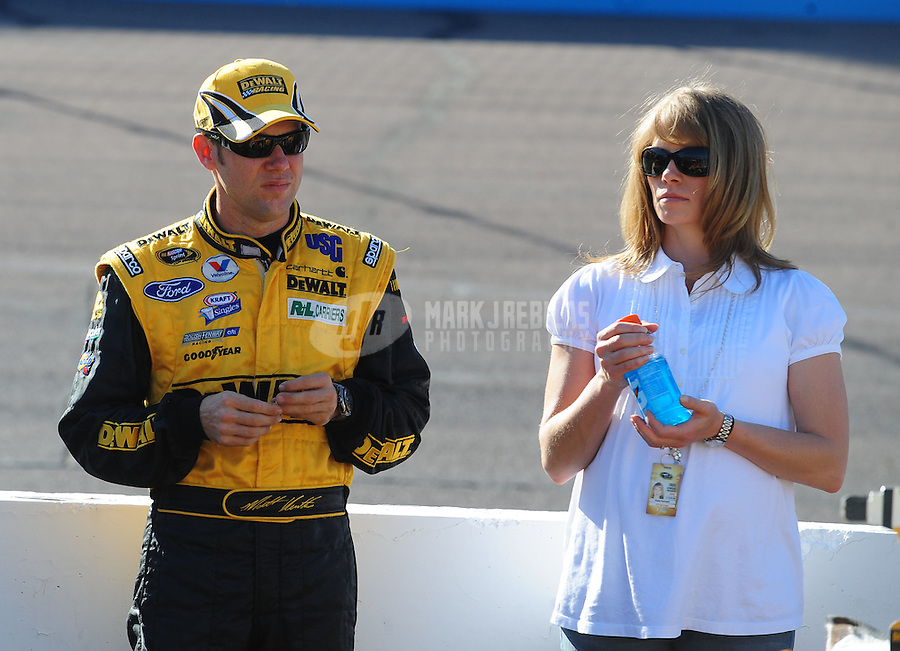 Apr 17, 2009; Avondale, AZ, USA; NASCAR Sprint Cup Series driver Matt Kenseth with wife Katie Kenseth during qualifying for the Subway Fresh Fit 500 at Phoenix International Raceway. Mandatory Credit: Mark J. Rebilas-