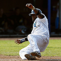 03 September 2011: Mervin Gario of the Vaessen Pioniers slides safely into home plate during game 1 of the 2011 Holland Series won 5-4 in inning number 14 by L&D Amsterdam Pirates over Vaessen Pioniers, in Hoofddorp, Netherlands.