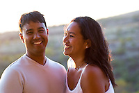 Local part Hawaiian couple at sunset