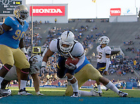 Isi Sofele of California scores a touchdown during the game against UCLA at Rose Bowl in Pasadena, California on October 29th, 2011.  UCLA defeated California, 31-14.