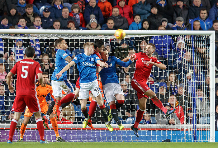 James Tavernier, Ross McCrorie and Danny Wilson clear the danger