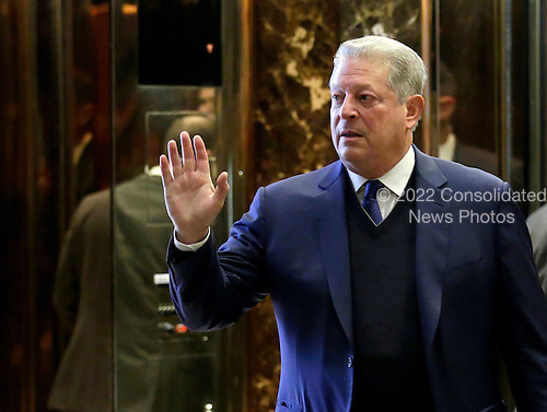 Former United States Vice President Al Gore waves as he exits the elevators at Trump Tower on December 5, 2016 in New York City. U.S. President-elect Donald Trump is still holding meetings upstairs at Trump Tower as he continues to fill in key positions in his new administration. <br /> Credit:John Angelillo / Pool via CNP