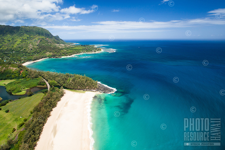 An aerial view of Lumaha'i Beach and Wainiha Bay near the St. Regis Princeville Resort, northern Kaua'i.