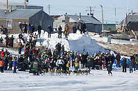 Sunday March 11, 2007   ----    Jeff King arrives in first place to a huge crowd at Unalakleet on Sunday afternoon.