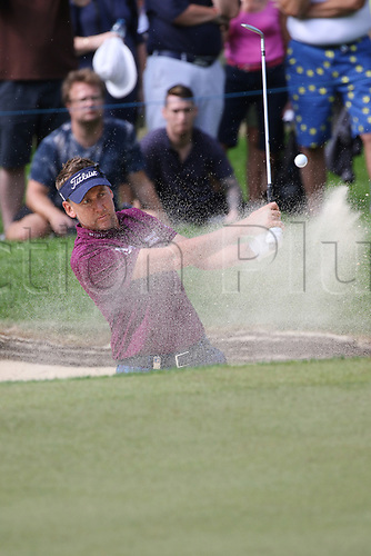May 25th 2017, Virginia Water, Wentworth, Surrey, England; BMW PGA Championship golf, day 1; Ian Poulter plays out of the bunker on the 15th