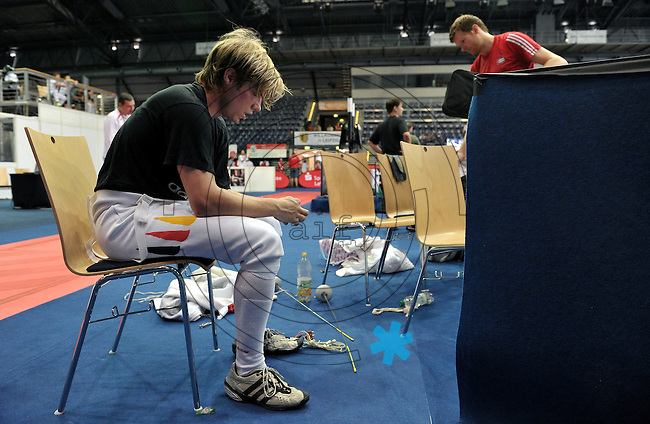 European Championships Fencing 2010 / Fecht Europameisterschaft 2010 in Leipzig - Competition Championat d'europe - in picture: The German mens foil team loses the match against Great Britian (45:41) - Peter Joppich was the last for the Germans - he sits disappointed on a chair after the match   . Foto: Norman Rembarz..Norman Rembarz , Autorennummer 41043728 , Augustenstr. 2, 04317 Leipzig, Tel.: 01794887569, Hypovereinsbank: BLZ: 86020086, KN: 357889472, St.Nr.: 231/261/06432 - Jegliche kommerzielle Nutzung ist honorar- und mehrwertsteuerpflichtig! Persönlichkeitsrechte sind zu wahren. Es wird keine Haftung übernommen bei Verletzung von Rechten Dritter. Autoren-Nennung gem. §13 UrhGes. wird verlangt. Weitergabe an Dritte nur nach  vorheriger Absprache..