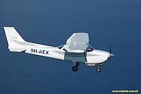 Air-to-Air images of Aircraft, Paragliding, Parasailing, Aerial filming of Agora.