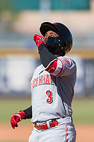 Scottsdale Scorpions shortstop Alfredo Rodriguez (3), of the Cincinnati Reds organization, kisses his hand while looking to the sky after hitting a single during an Arizona Fall League game against the Peoria Javelinas at Peoria Sports Complex on October 18, 2018 in Peoria, Arizona. Scottsdale defeated Peoria 8-0. (Zachary Lucy/Four Seam Images)
