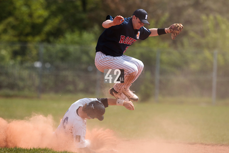 25 April 2010: Aaron Hornostaj of Rouen jumps over Nicolas Dubaut of the Puc during game 1/week 3 of the French Elite season won 12-4 by Rouen over the PUC, at the Pershing Stadium in Vincennes, near Paris, France.