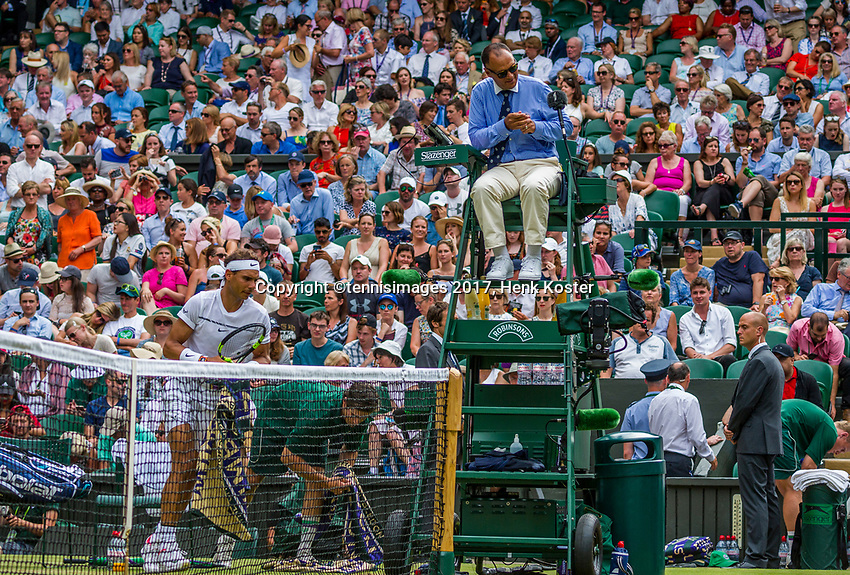 London, England, 7 th July, 2017, Tennis,  Wimbledon,  Rafael Nadal (ESP) and in the Umpire chair Mohamed Lahyani<br /> Photo: Henk Koster/tennisimages.com