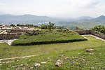 The lower ball court in the ruins of the Zapotec city of Atzompa, near Oaxaca, Mexico.  In the background is the Central Valley and city of Oaxaca.
