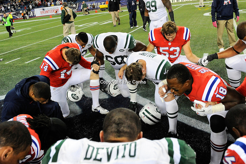 October 21, 2012 Members of both the New England Patriots and New York Jets meet midfield for to pray at the end of the New England Patriots vs New York Jets game played at Gillette Stadium in Foxborough, Massachusetts.   Eric Canha/CSM